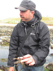 Juan with a Velvet Swimming Crab found in a rockpool (it was returned to the pool safely)
