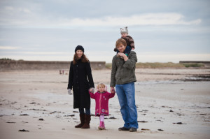 Roland with his family having a walk on the beach