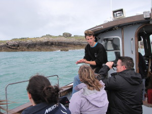 Tim describes how a puffins bill works to catch fish to the visitors